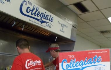 Two People Working at Collegiate Grill